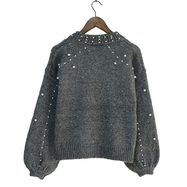 Gros pull court à perles