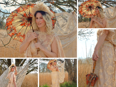 A glamorous look - Jenny wears a floor sweeping gown in gold lace from the 1970's, with a showgirl headdress and antique parasol