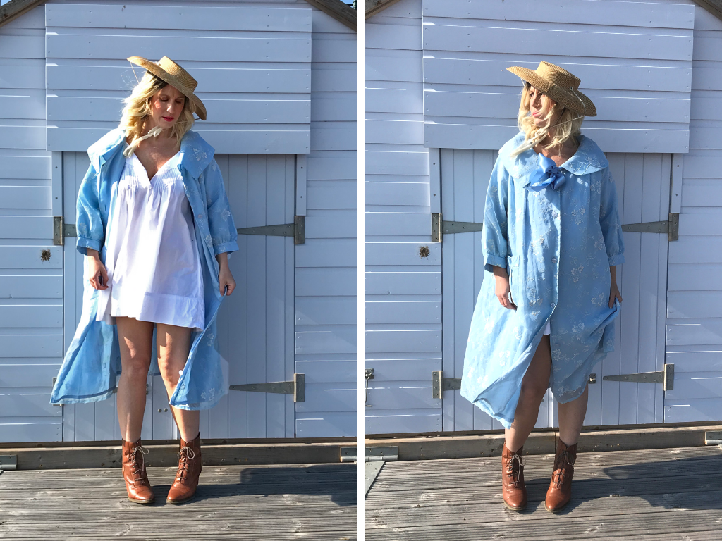 Two shots of blogger and influencer Jenny Mandera, standing in front of a pale blue beach hut on Budleigh beach. In the left hand image, she wears a sky blue flocked organza swing coat, an original fifties coat from our collection. She has teamed it with a straw hat and tan ankle boots. In the second image, she has unbuttoned her coat to show the Edwardian nightshirt beneath, the wind whipping her blonde hair across her face.