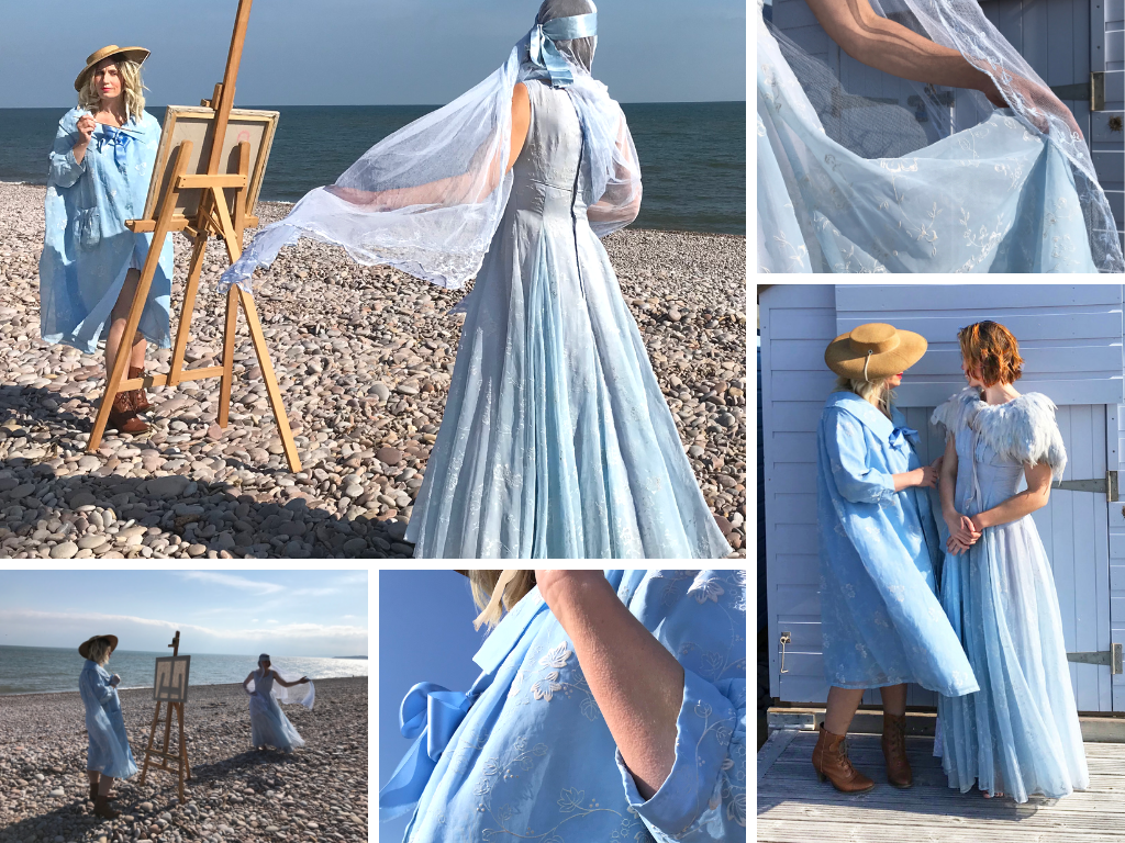 A montage of images of our models on a pebble beach, wearing original vintage blue flocked organza outfits. Josie wears a floor length 1950's dress with a pale blue antique veil flowing from a satin headband. Jenny poses at an easel, paintbrush in hand as though painting Josie, wearing a stylish 1950's swing coat in sky blue