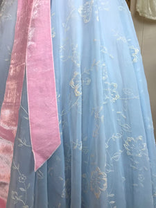 A close up showing the velvety texture of the flocked organza on a fifties ball gown / prom dress