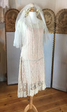 1920's lace wedding dress with dropped hem , cream lace over a peach slip, twenties veil with orange blossom