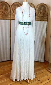 Elegant 1940's wedding dress created in a Victorian style with long sleeves and a high neck made in ivory lace