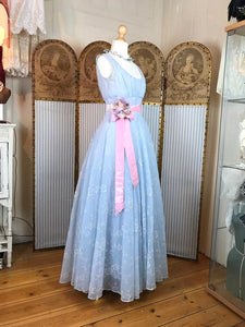 Beautiful pale blue 50's dress with a pink satin sash and waist corsage