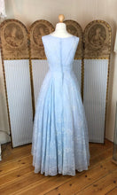 back view of a floor length 1950's pale blue ballgown with a soft, full skirt