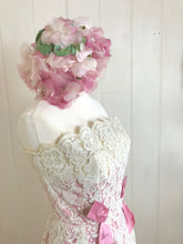 add a stylish hat to this pink and cream 1960's vintage dress for a look worthy of the races