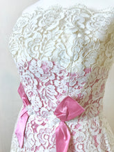 Close up of the french lace and rose pink silk taffeta inserts on a boned wedding dress from the sixties - for sale