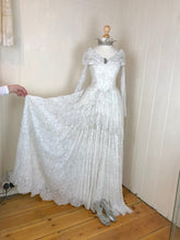 A generous amount of fabric makes up the skirt of this stunning vintage lace ball gown / wedding dress