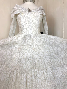 This shot shows details of the front of a beautiful 1950's wedding dress made from ivory lace with silver threadwork - perfect for a snow queen or ice princess!