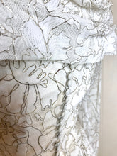 A detail of the self covered buttons which adorn a beautiful lace wedding gown from the fifties