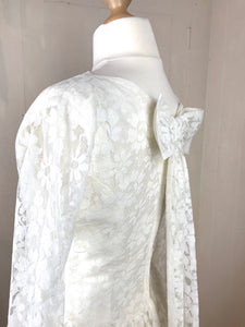 Side back angle of a beautiful lace bow on an original 50's wedding dress