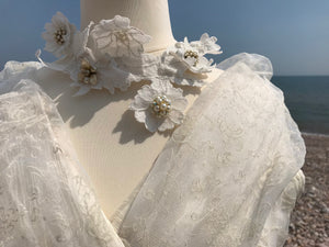 A close up of the shawl collar in translucent ivory organza on a 1950's wedding gown