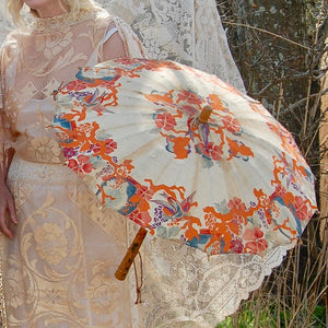 a close up of a classic art deco 1920's parasol - original vintage / antique silk parasol