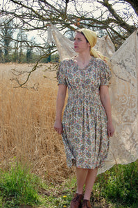 Our model wears a forties print dress with flat boots and a yellow headscarf - true forties fashion!
