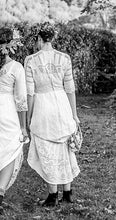 The back view of a white Edwardian lace dress, showing the exquisite  hand worked lace panels.
