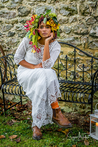 Gorgeous and unique autumn bridal look  - an Edwardian lace gown is teamed with a vibrant, oversized flower crown and brown leather boots