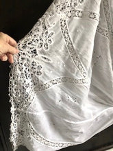 Close up the handmade bedfordshire lace and tape work on an Edwardian antique wedding gown