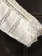 Close up of the handmade lace and broderie work on the sleeve cuff of an Edwardian wedding dress