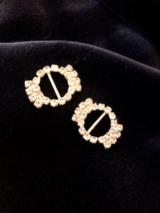 A pair of vintage glass diamond shoe buckles