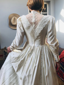 Back view - Edwardian replica wedding gown with a high neck and deep lace V in the back. The dress has a tiny waist and is reminiscent of Princess Diana's wedding dress with it's dreamy romantic feel