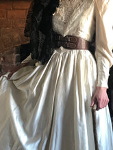 Historical replica costume - an Edwardian replica dress is shown styled in prairie fashion with a shawl and belt