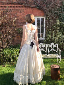An elegant ivory silk Victorian corset wedding dress is laced with black lacings. The dress is in fact two separates - a corset top and full skirt. The dress could be worn as a wedding dress or a Victorian costume