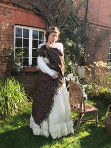 This time, the Victorian wedding dress is teamed with a chunky vintage wool knit sweater and brown paisley shawl. Our charming model bride wraps the shawl tenderly about herself, recalling a Victorian picture postcard of a costumed girl