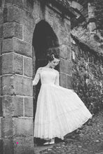 ankle length fifties lace wedding dress with long sleeves and a full skirt