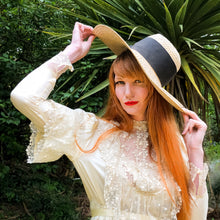 new romantic bride in edwardian style silk gown with a large vintage sunhat. Red headed model smoulders with Belle Epoch flair