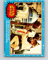 1977 OPC Star Wars #14 Luke checks out his new droid   V33597