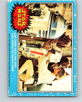 1977 OPC Star Wars #14 Luke checks out his new droid   V33598