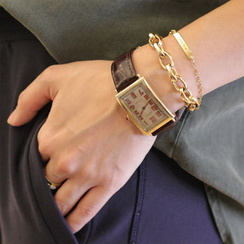 "A layered look with our 18K Yellow Gold ""Carpe Diem"" Petite Poesy Bracelet"