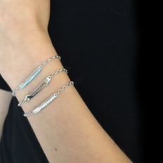 "a layered look with our ""I love you more"", ""Never Fear"" and Carpe Diem Poesy Bracelets"