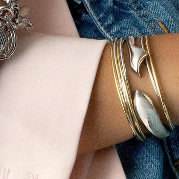 Silver Charm Bracelets, Silver Fish Cuff, and Silver Lining Poesy Cuffs