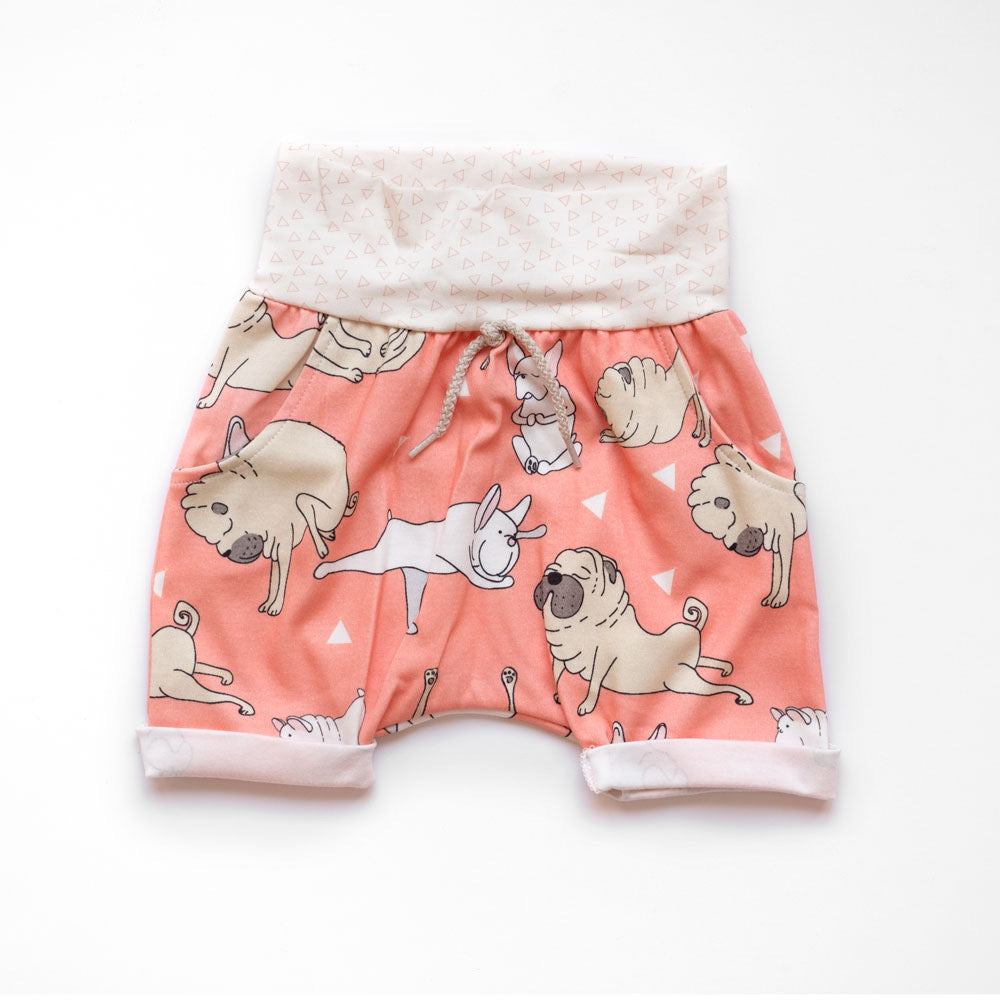 Front of Little Pugs Coral grow-with-me shorts by Little Yogi | Tiny Squirrel