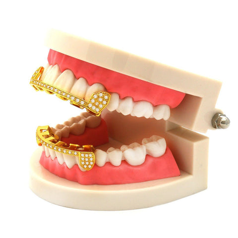 GRILLZ SET GOLD FANG CZ HALF LINE