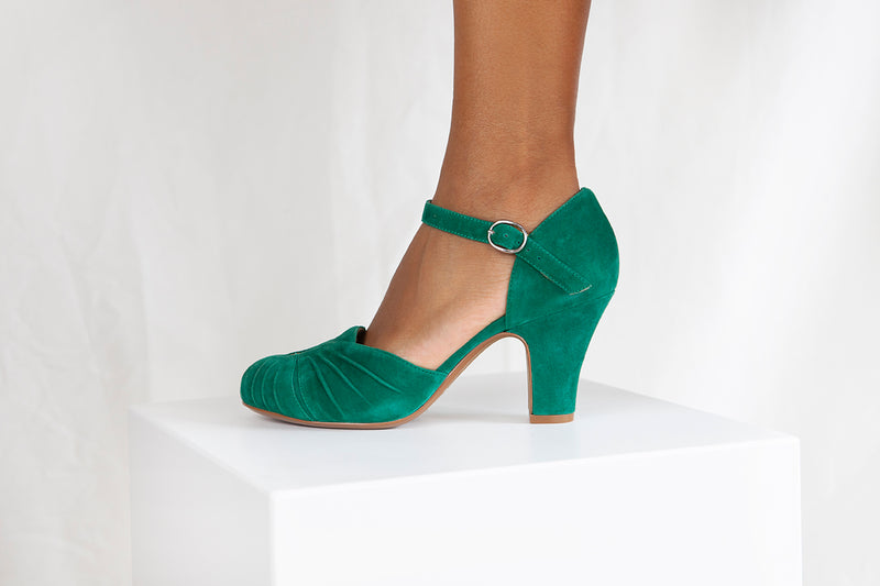 Amber in emerald green suede by designer Miss L Fire is a two part bar shoe with ruching detail. Vintage inspired, ethically made.