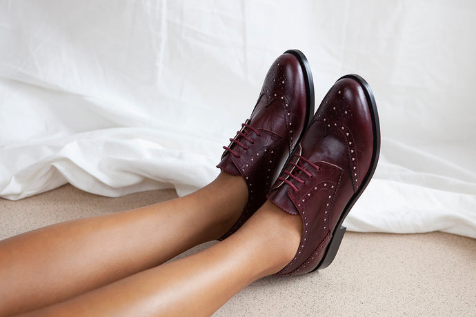 Audrey  lace up brogue in luxurious deep red wine leather with heart shapes cut outs. All leather upper, lining and outsole. Made in Portugal by Miss L Fire.