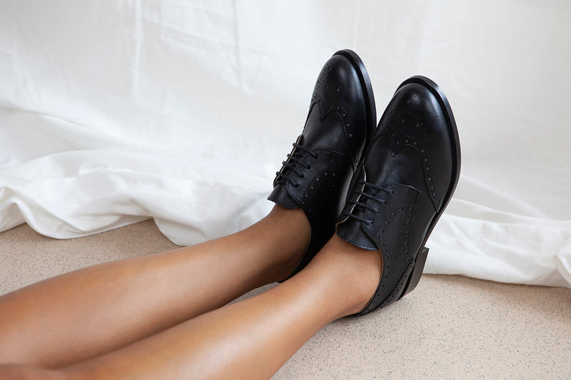 Audrey in black leather is the perfect classic lace up brogue with heart shaped cut-outs. All leather, made in Portugal by Designer Miss L Fire.