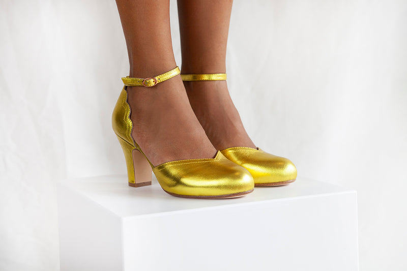 Layla is a two part shoe with scallop detail and adjustable ankle strap in luxurious gold metallic leather. By Miss L Fire.