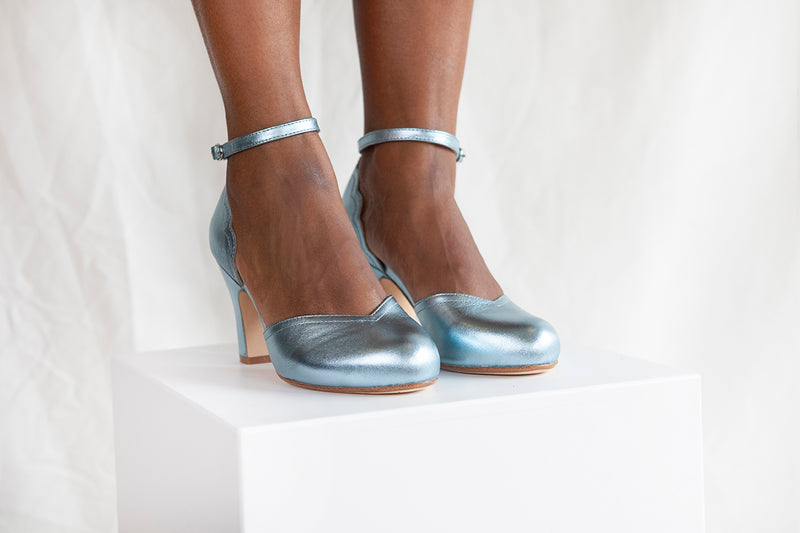 Layla in pale sky blue metallic leather is a scalloped detail two part shoe with three inch heel and adjustable ankle strap. By Miss L Fire.