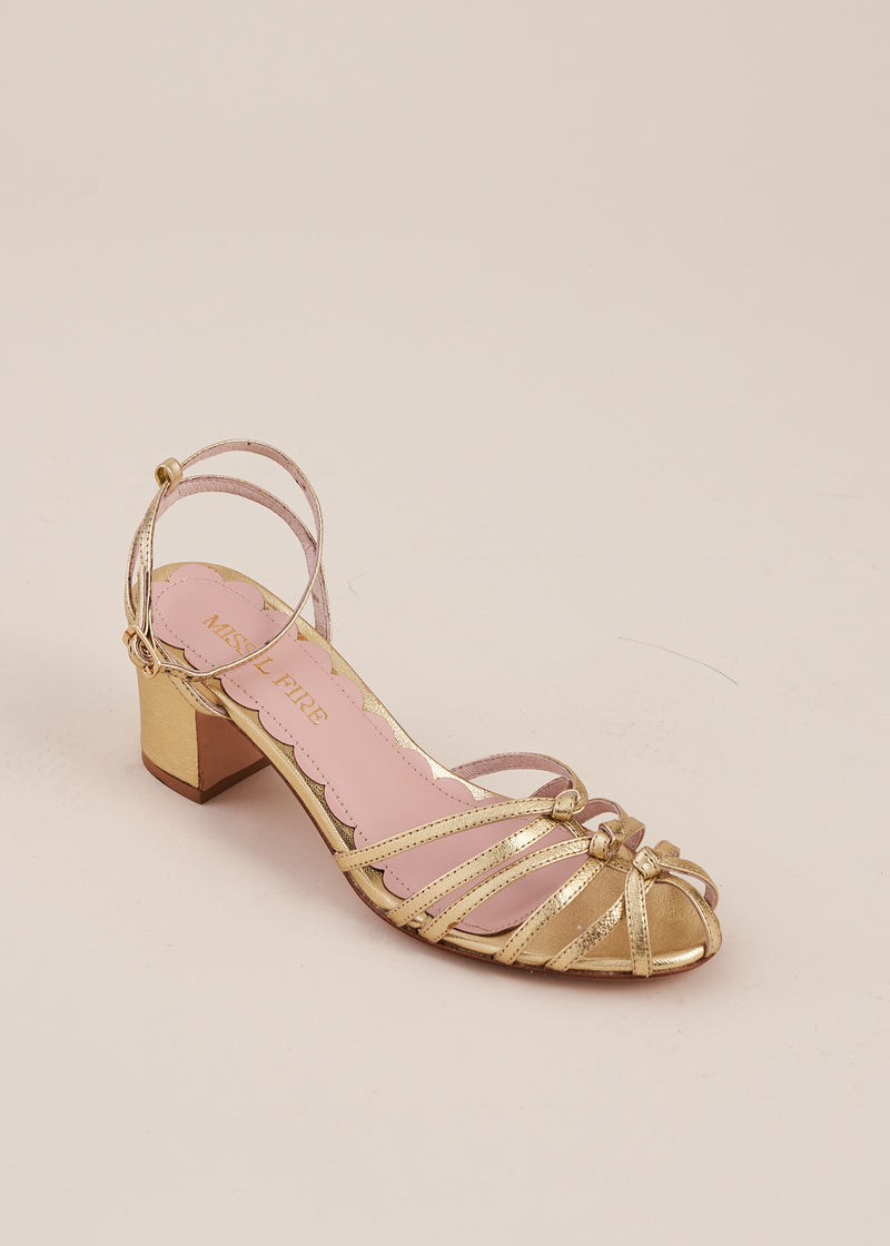 Lois is a luxurious pale gold strappy knot sandal with two inch heel and adjustable ankle strap by Miss L Fire.
