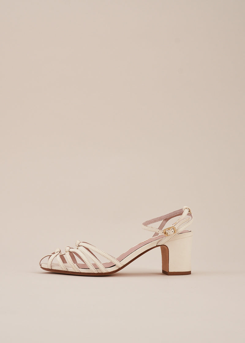 The Lois strappy knot sandal in soft white leather on two inch heel with adjustable ankle strap. Perfect bridal sandal. By Miss L Fire.