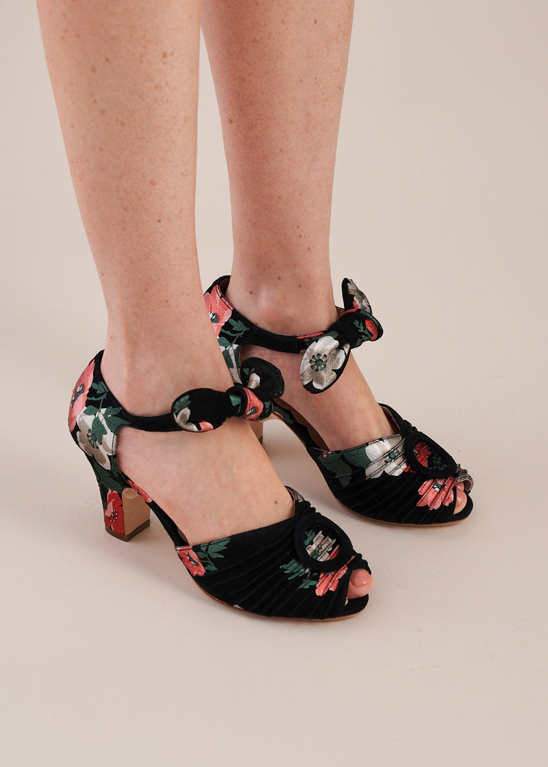 Loretta in black floral print suede is a peep toe ankle tie sandal with three inch heel by Miss L Fire. Limited edition, ethically made.