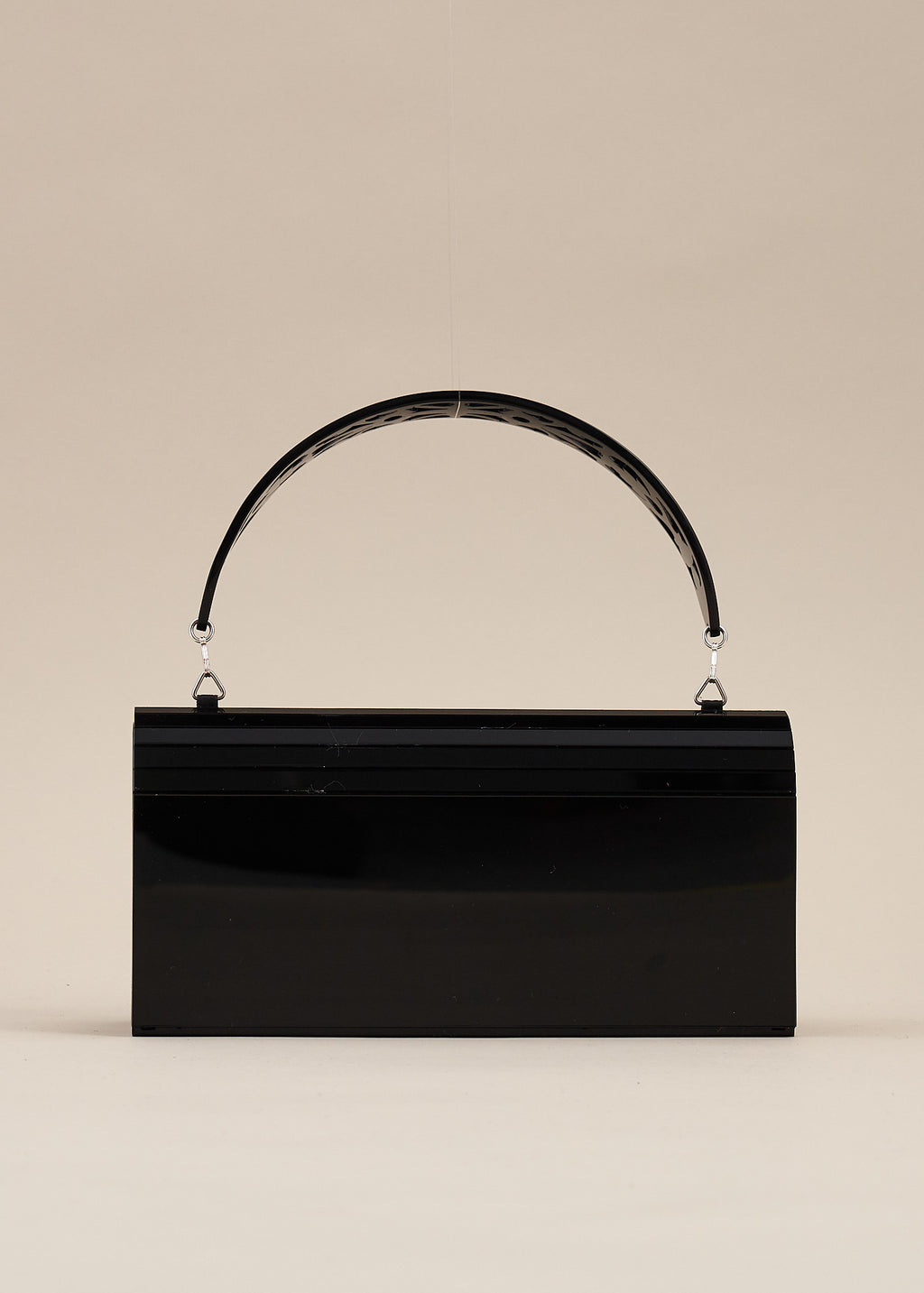Francesca carved jet-black lucite handbag by Miss L Fire. Features a detachable handle so that the purse can be worn also as a clutch bag. Perfect for  brides or bridesmaids. Handmade in Barcelona.
