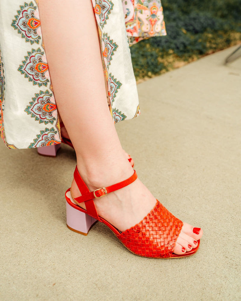 Red woven leather sandals with lilac contrast heel. Available at Miss L Fire, Mission Street, San Marino, California.