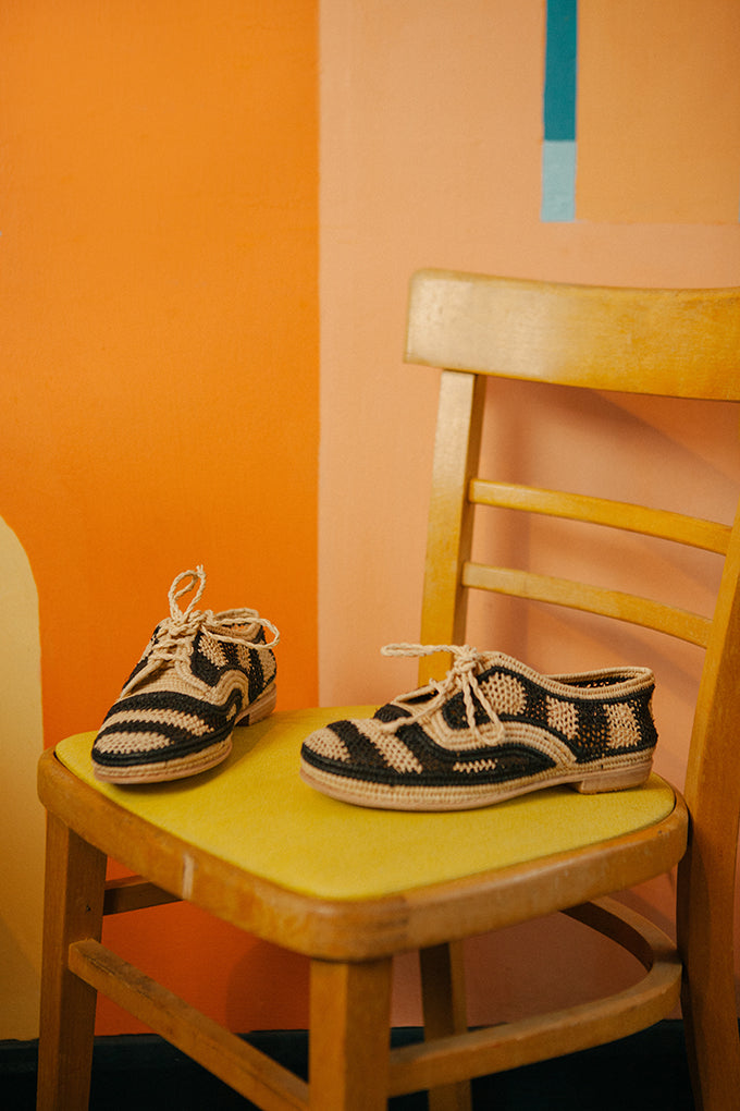 Miss L Fire hand woven raffia shoes in black and white stripes. Small batch, eco friendly, hand made in Morocco.
