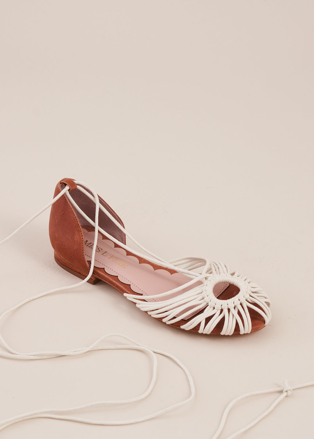 Penelope in natural is a ballet flat with a cotton cord hand woven macrame upper, tan leather heel counter and cord ankle tie straps.  By Miss L Fire. Limited edition, ethically made.