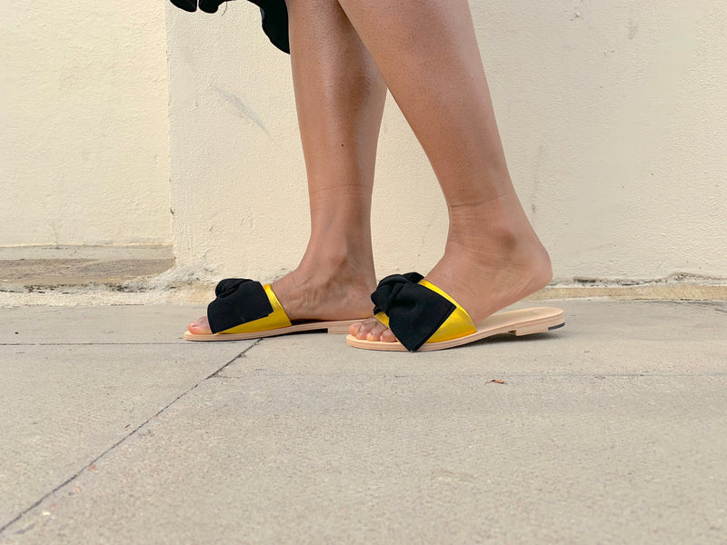 Gold leather and black suede Serafina flat leather slide sandal by Miss L Fire. Online exclusive.