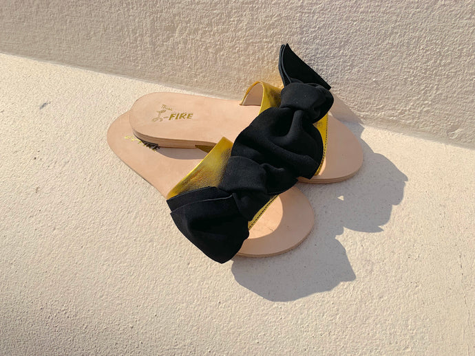 Serafina flat slide in gold leather and black suede with hand tied bow trim by Miss L Fire. Online Exclusive